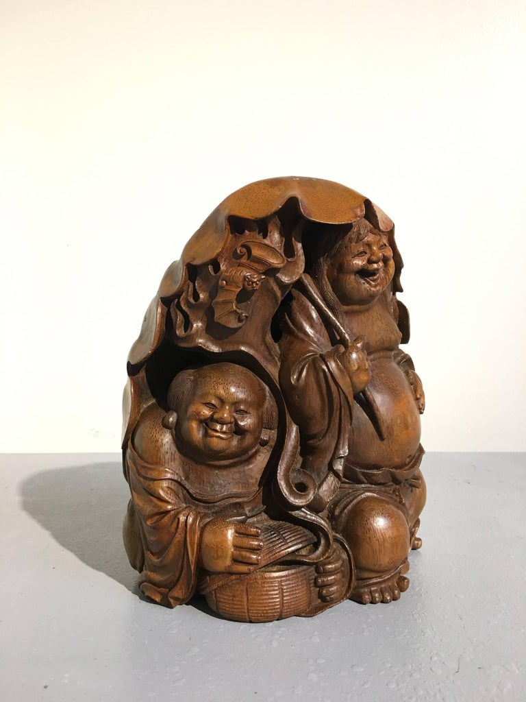 A wonderful Chinese bamboo figural carving featuring the Taoist immortal twins of eternal youth, known as the HeHe ErXian, Qing dynasty, 19th century.  Finely carved from a single large section of bamboo root, the twins of mirth and harmony, often