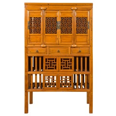 Chinese Qing Dynasty Elm Kitchen Cabinet with Fretwork Motifs and Sliding Panels
