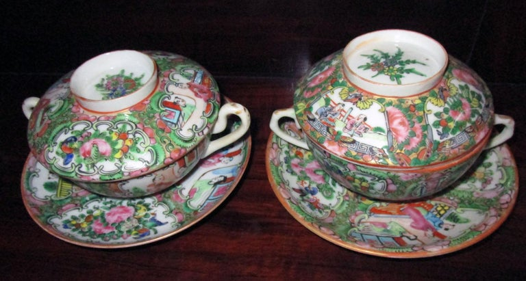 Set of six (eighteen pieces in all) Chinese Qing rose medallion porcelain soup bowls with two handles and lids that double as rice bowls. Matching saucers. Features include traditional medallion design with figures in village scene, floral and bird