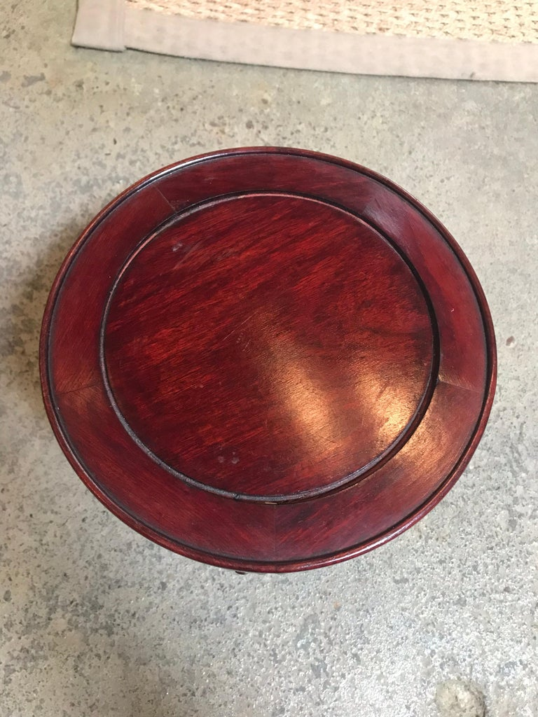 This Chinese rosewood stand displays a brilliant red sheen. It's tabletop sized and can hoist anything into the limelight using a little elevation and a lot of elegance.