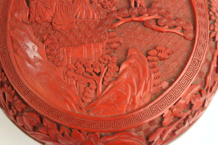 Mid-20th Century Chinese Round Cinnabar Box with Carved Scene of Five Scholars in a Garden For Sale
