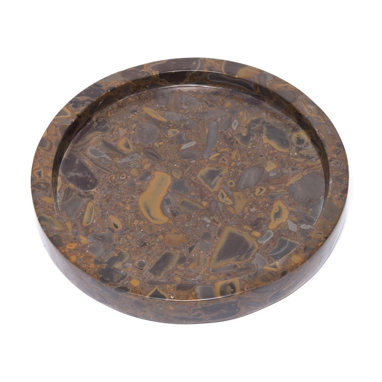Named for its unique composite nature, puddingstone is a conglomerate stone indigenous to southern China. Prized by scholars for generations, the abstract patterns were an invitation for contemplation. This contemporary tray is hand carved into a