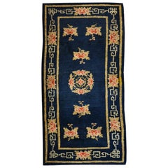 Chinese Rug, Flower Design and Geometries over Blue Background, circa 1930