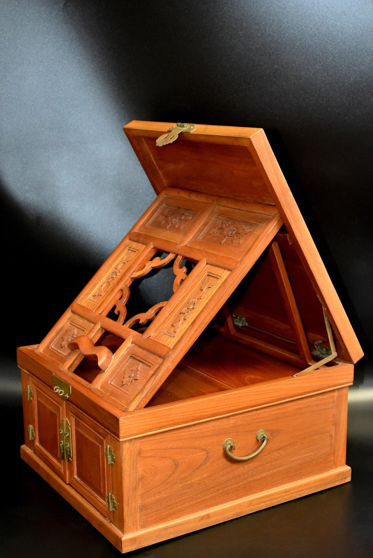 A beautiful, solid elm wood, never used, jewelry box with carved flowers and three full length drawers. The box opens to support the mirror stand. There are two positions for the mirror to be held. Box is 9