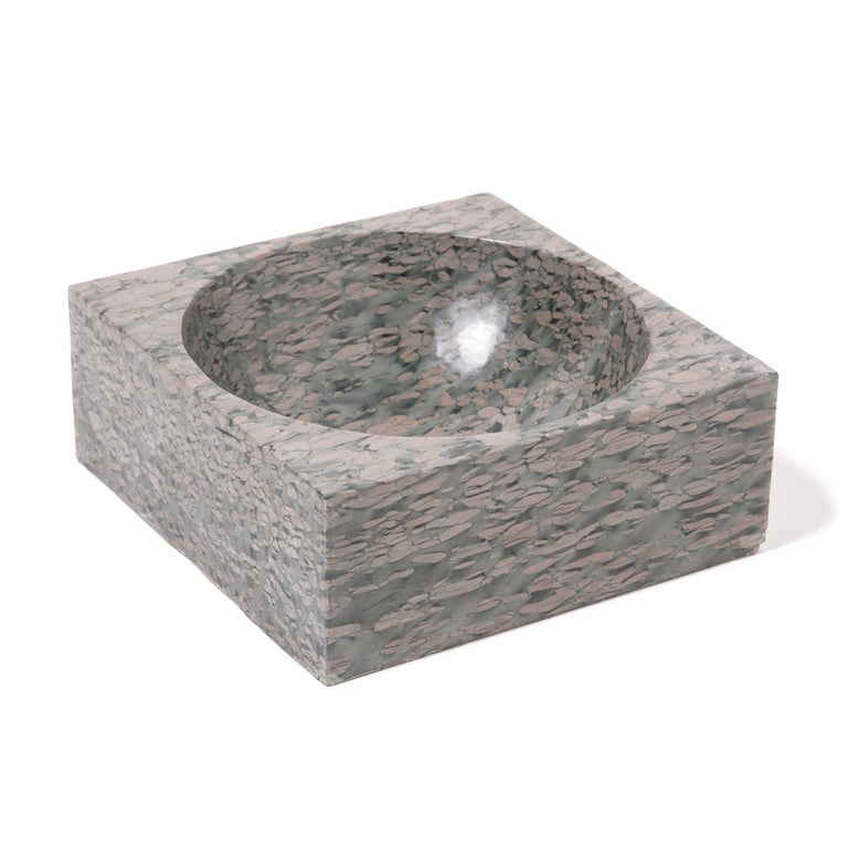 A clean-lined interpretation of an ancient form, this stone basin was hand carved with a rounded interior within finely edged square form. The basin looks meticulously painted, but the mesmerizing pattern of zhenzhu is inherent to the stone, a