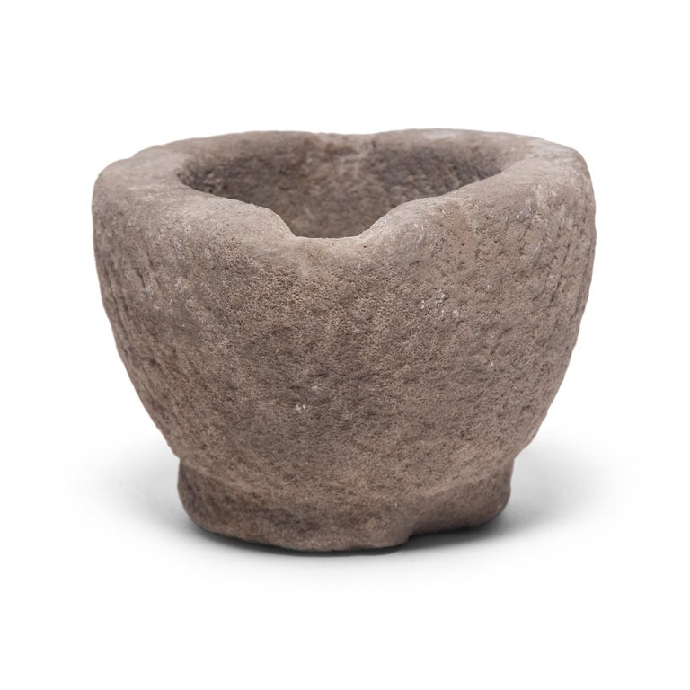 Hand carved from a single block of limestone, this round stone vessel is an early 20th century mortar once used daily in a Provincial kitchen to grind herbs, spices, and other foods. Used as a decorative vessel or tabletop planter, the mortar's