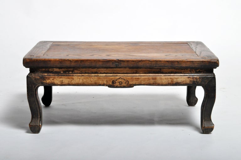 This Chinese tea table is from Beijing, China, and was made from elmwood, circa 1900. The piece features its original beautifully aged patina. Wear consistent with age and use.