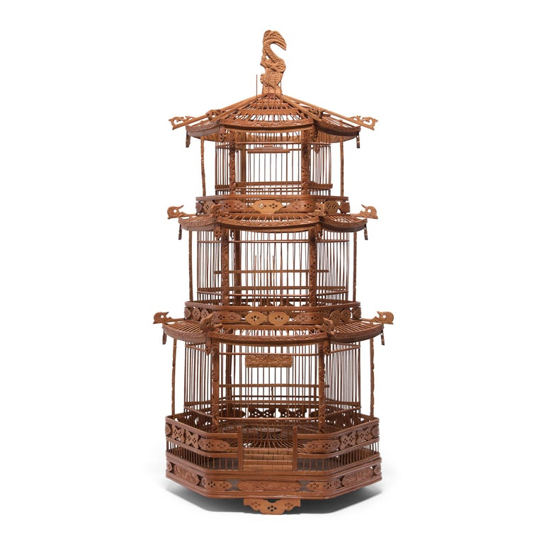 A triumphant display of grandeur and fine craftsmanship, this monumental bird cage was once home to the pet bird of a Qing-dynasty aristocrat. Dated to the late 19th century, the cage was carefully assembled into the shape of a towering three-tiered
