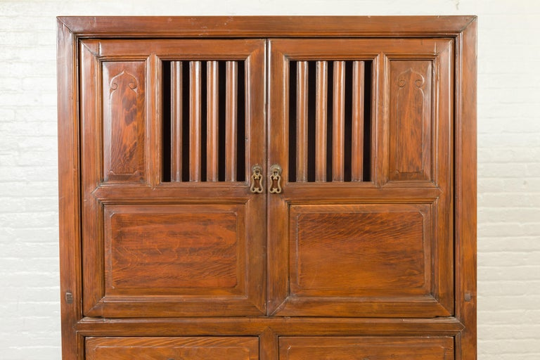 Chinese Vintage Cabinet with Fretwork Design, Doors and Drawers For Sale 6
