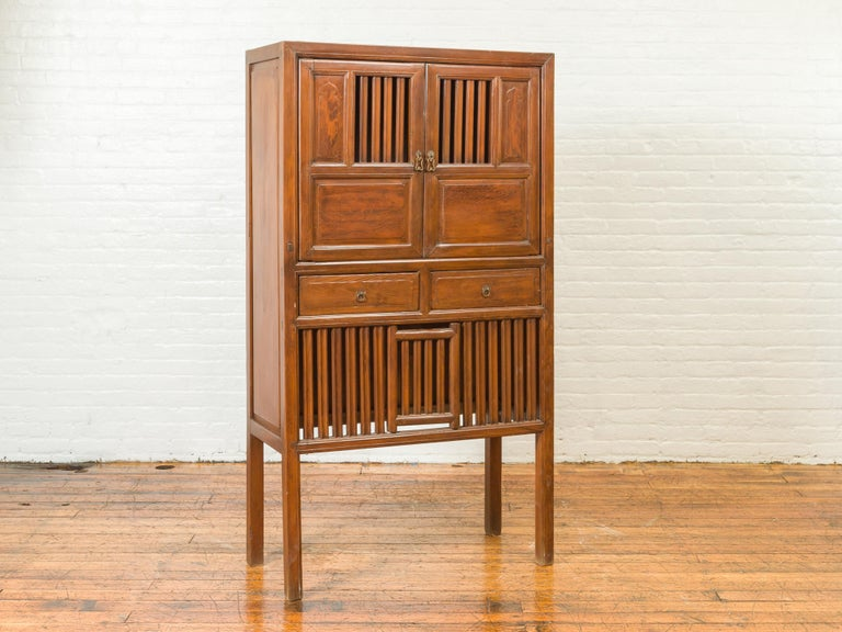 Chinese Vintage Cabinet with Fretwork Design, Doors and Drawers In Good Condition For Sale In Yonkers, NY