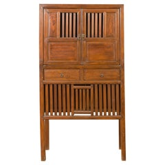 Chinese Vintage Cabinet with Fretwork Design, Doors and Drawers