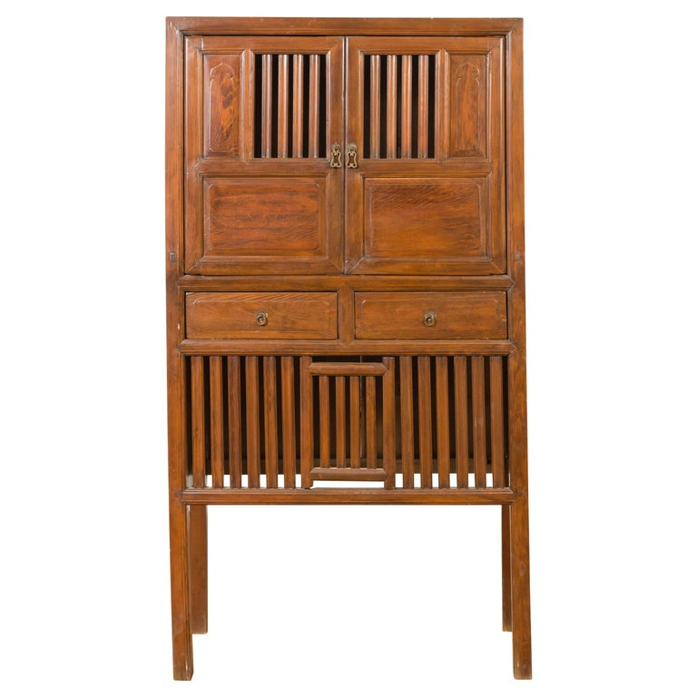 Chinese Vintage Cabinet with Fretwork Design, Doors and Drawers For Sale