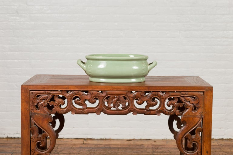 Chinese Vintage Celadon Foot Bath with Two Handles and Foliage Motifs In Good Condition For Sale In Yonkers, NY