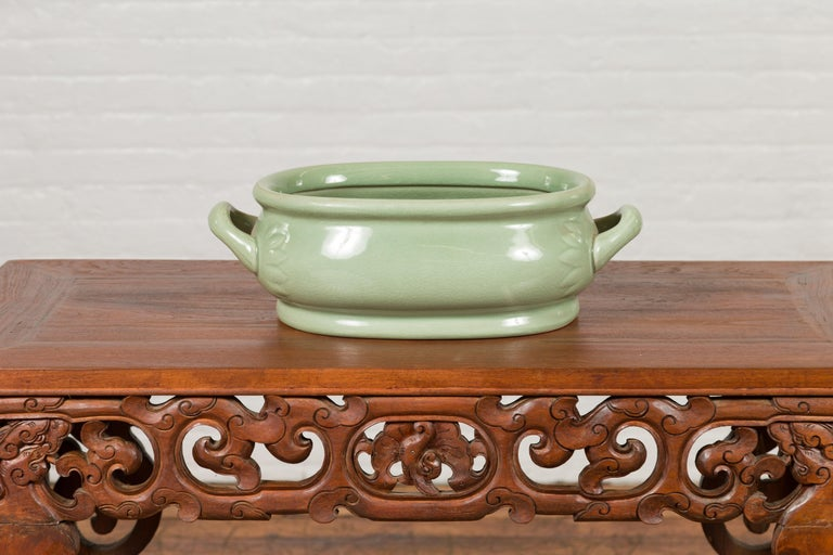 Chinese Vintage Celadon Foot Bath with Two Handles and Foliage Motifs For Sale 1