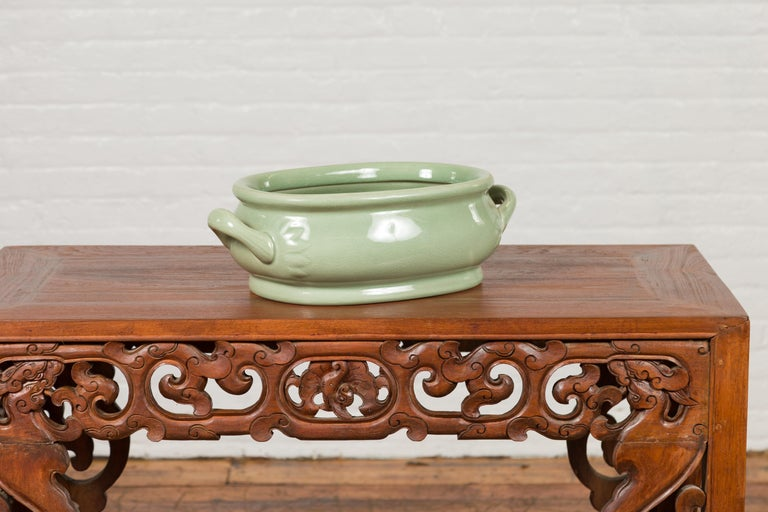Chinese Vintage Celadon Foot Bath with Two Handles and Foliage Motifs For Sale 5