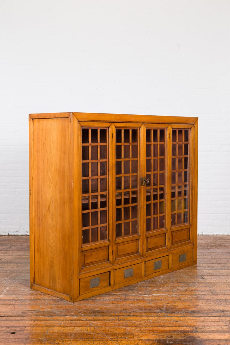 Chinese Vintage Display Cabinet with Paneled Glass Doors and Four Drawers In Good Condition For Sale In Yonkers, NY