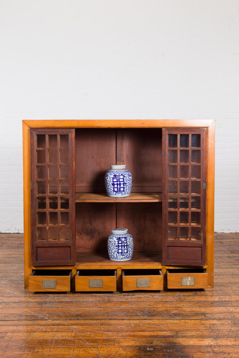 20th Century Chinese Vintage Display Cabinet with Paneled Glass Doors and Four Drawers For Sale