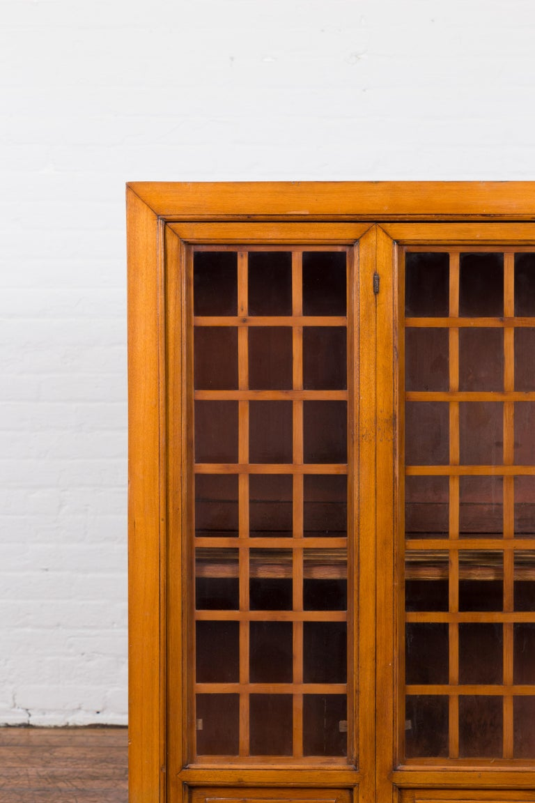 Chinese Vintage Display Cabinet with Paneled Glass Doors and Four Drawers For Sale 1