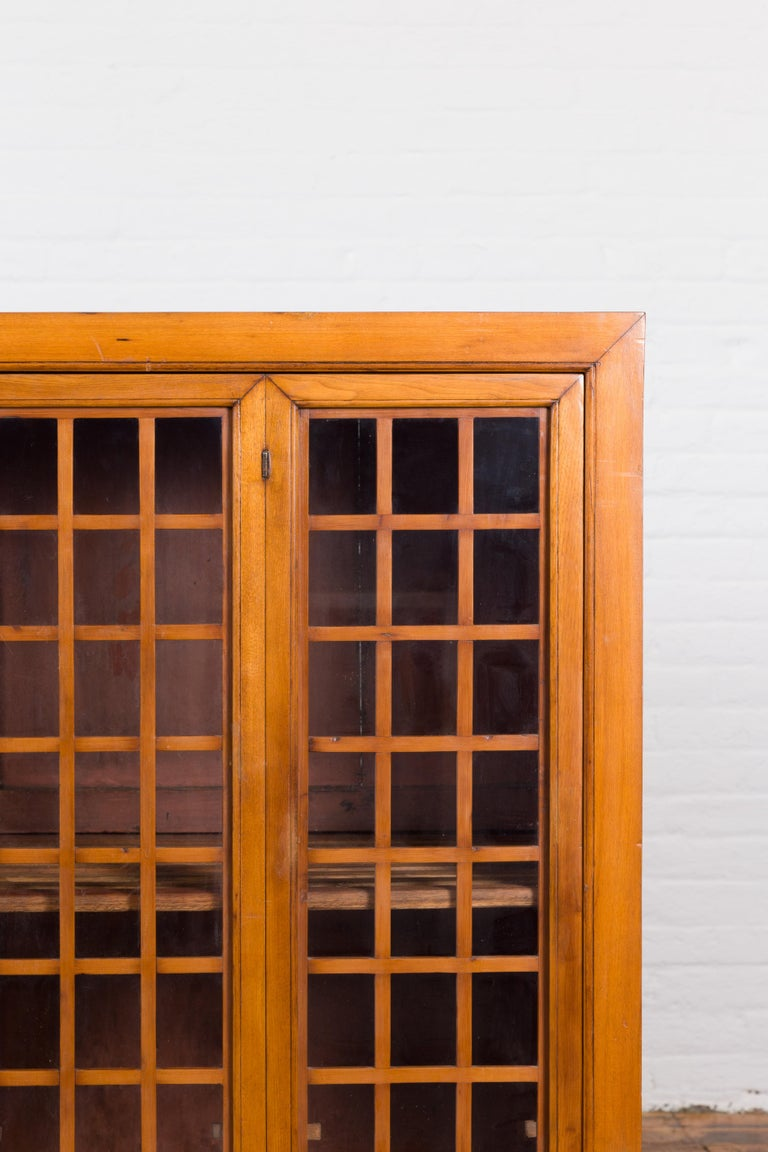 Chinese Vintage Display Cabinet with Paneled Glass Doors and Four Drawers For Sale 3
