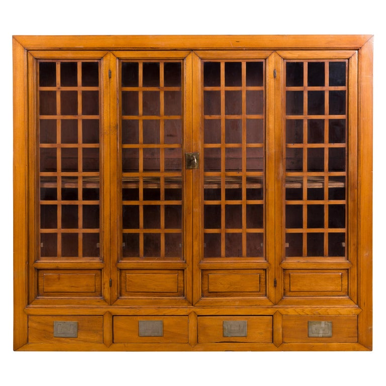 Chinese Vintage Display Cabinet with Paneled Glass Doors and Four Drawers For Sale