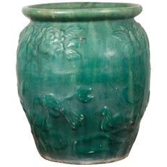 Chinese Vintage Green Glazed Vase with Raised Floral and Bird Motifs