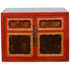 Chinese Vintage Small Red Lacquered Cabinet with Carved and Hand Painted Motifs