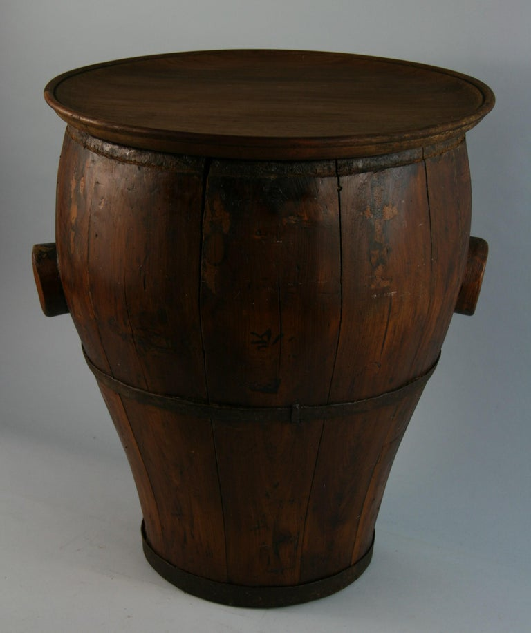 3-611 Chinese water storage barrel converted into side table/drink table.