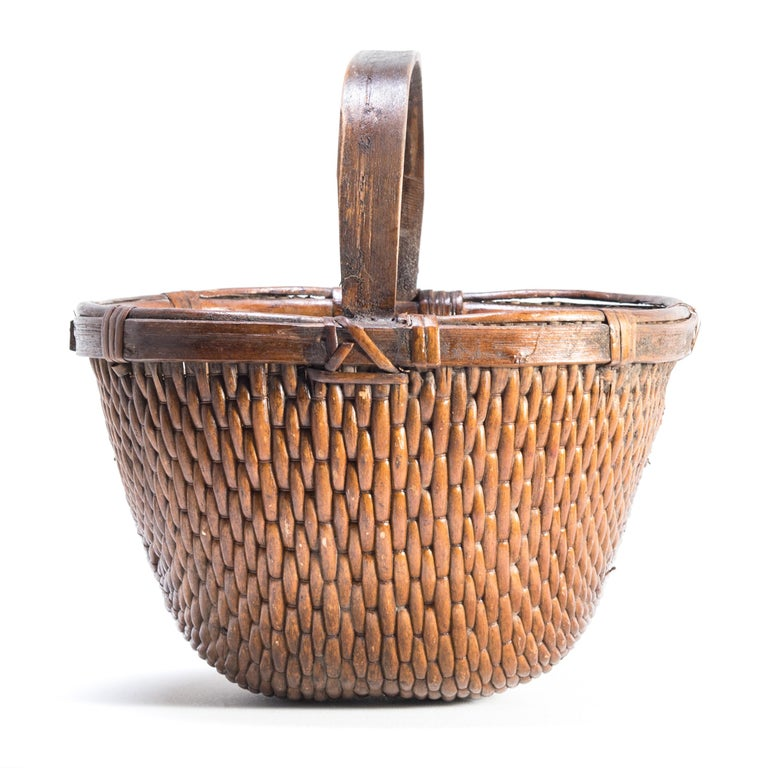 It is easy to imagine someone, long ago, walking to market on a beautiful summer day with this beautiful basket slung over their arm. Basket making is an ancient and humble craft, but in the hands of a truly skilled weaver willow branches, like