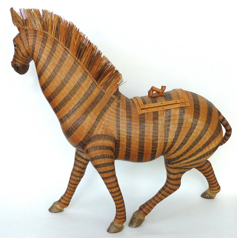 Chinese Woven Reed Zebra Trinket Box  Offered for sale is an intricately woven and finely detailed figure of a zebra from China, circa 1970. The zebra is not only a wonderful decorative object but also serves as a trinket box or basket. There is a