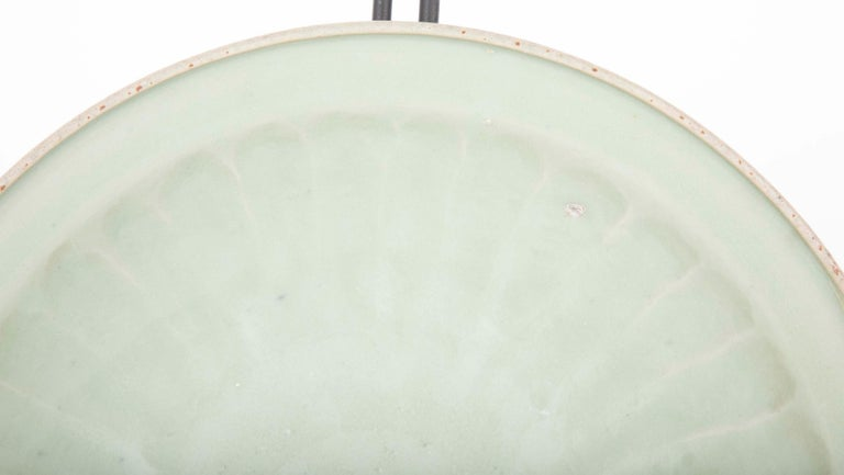 A beautiful Chinese Yuan celadon plate in green glaze finish having fluted edges.