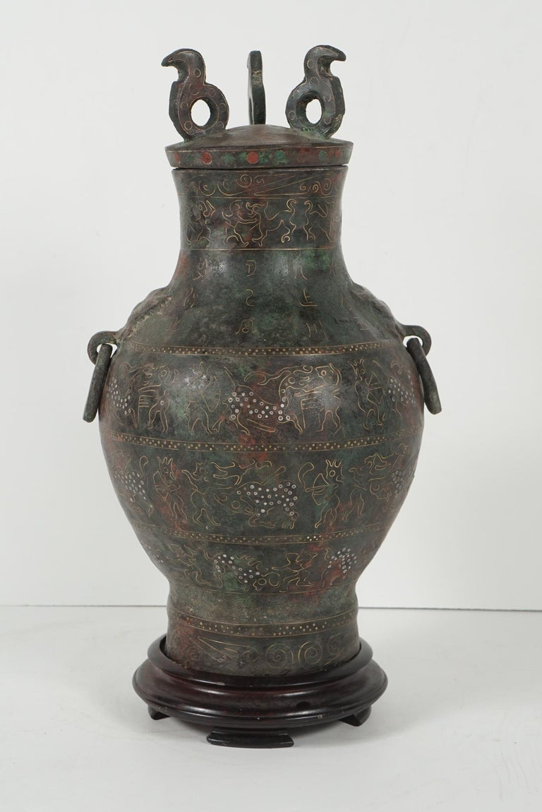 This cast bronze vessel was made in China as an honorific presentation circa 1920. Cast in the style of the Zhou dynasty it would have been used ritually as a wine container and placed in tombs as an offering. The Chinese have for centuries created