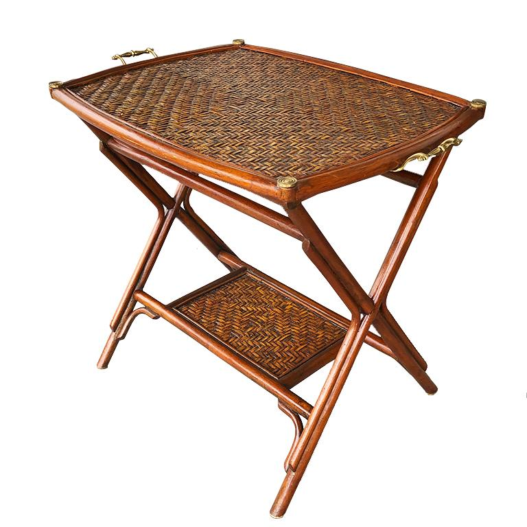 Authentic 1970's Bamboo, cane and brass two-tier butler or occasional tray table or nightstand. Made in 1970s from the Philippines by Maitland Smith. This beautiful bamboo tray table includes 2 tiers, all with brass details. The top portion is