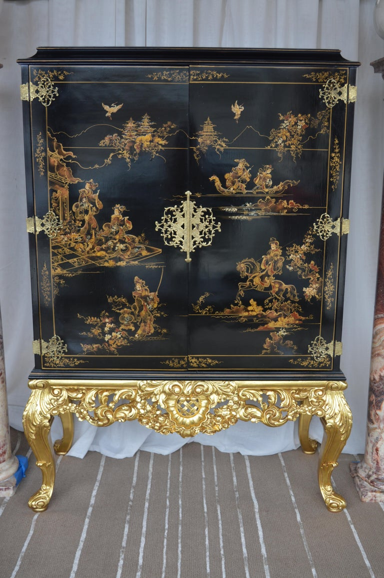Chinoiserie bar cabinet with a giltwood base.