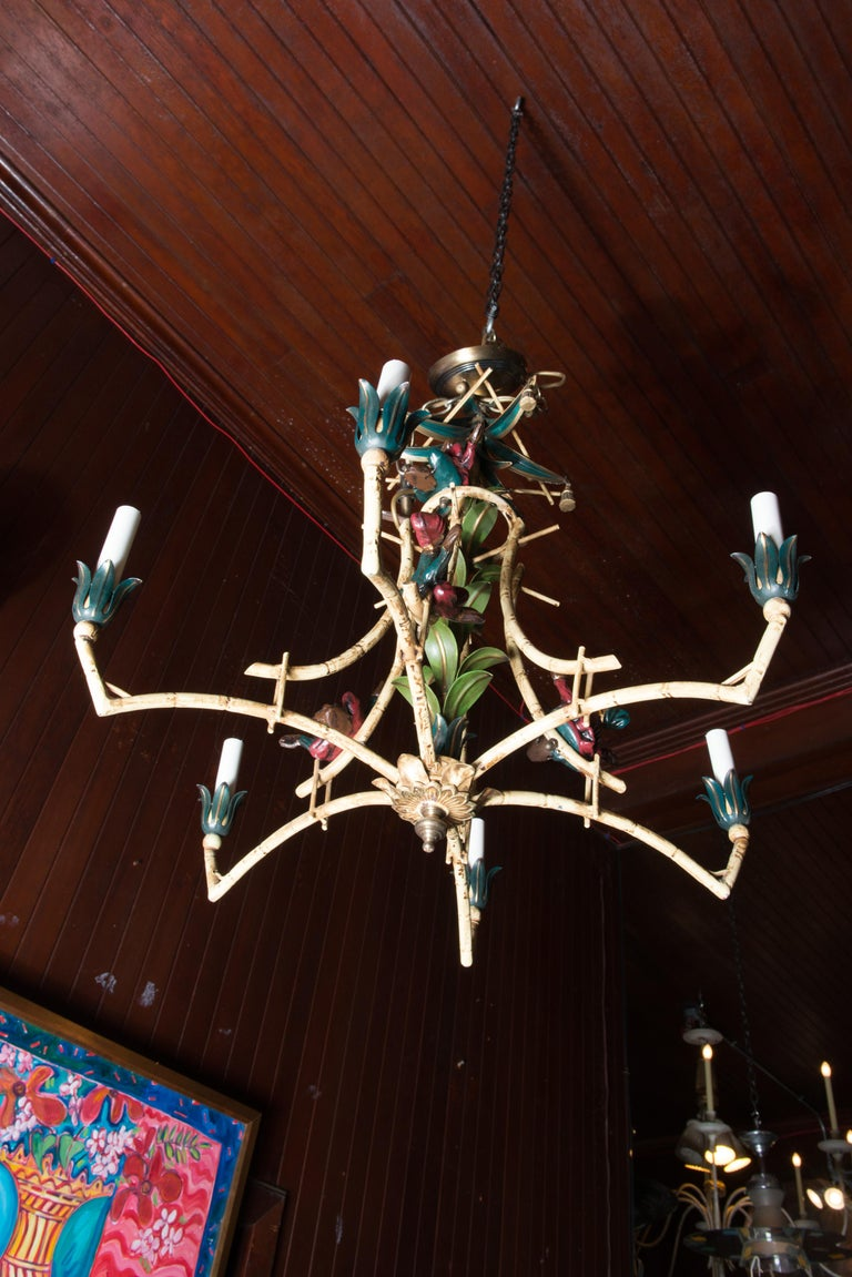 Painted iron Chinoiserie chandelier with decked out monkeys, tassels, and balls. Canopy and chain included. Accommodates six chandelier bulbs.