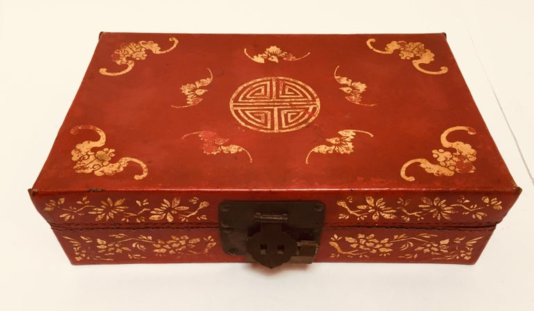 Chinoiserie red leather gilt hand painted oriental traveling box.