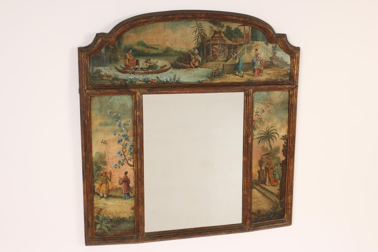 Italian giltwood and painted mirror with chinoiserie painted panels, 19th century. The painted panels are on paper. The gilding has darkened with age.