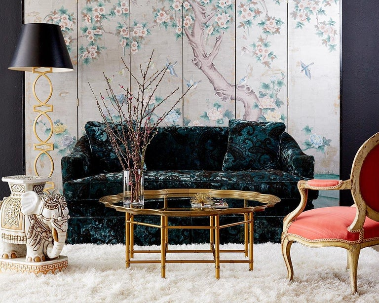Elegant and feminine chinoiserie six-panel wallpaper screen featuring a hand painted scene of flowers, birds, and butterflies over a hand-applied silver leaf background. Crafted from wood panels covered in a green textured wallpaper then carefully