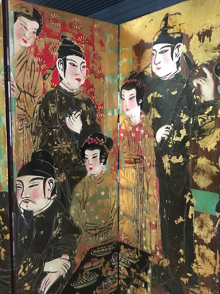 Large six panel hand-painted chinoiserie room divider folding screen featuring Asian Chinese figures and gold leaf accents. Each panel measures 19.75 Inches Wide.
