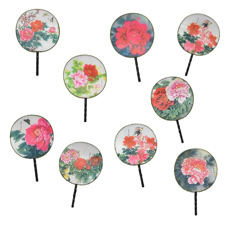 Set of 9 chinoiserie paddle fans. Each fan has an olive green hemmed band sewn on the exterior. The band has a lovely black geometric pattern on it. The center of the fans is printed on silk and in various prints of floral and fauna details.   The