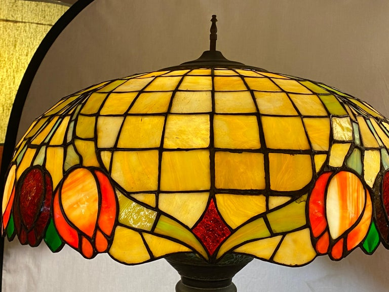 Chinoiserie Arts & Crafts style tall or floor lamp with Tiffany style stained glass shade. This 1930s or 1940s wonderfully decorative standing tall lamp is simply stunning with its Tiffany style shade. When one lights the lamp up it speaks volumes.