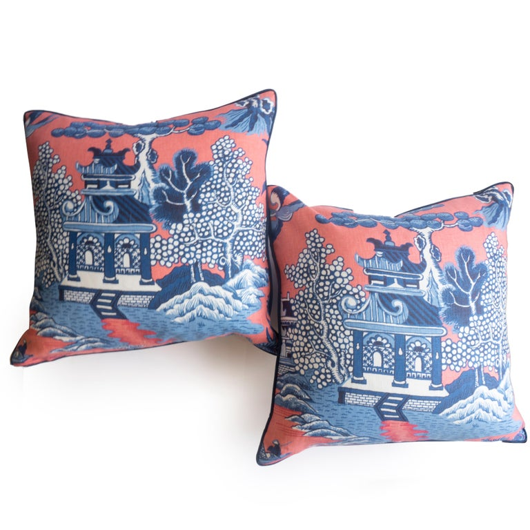 This pair of chinoiserie throw pillows were hand sewn at our studio in Norwalk, Connecticut. A vibrant scene of rural China is depicted in contrasting reds and blues.   Measurements: 20