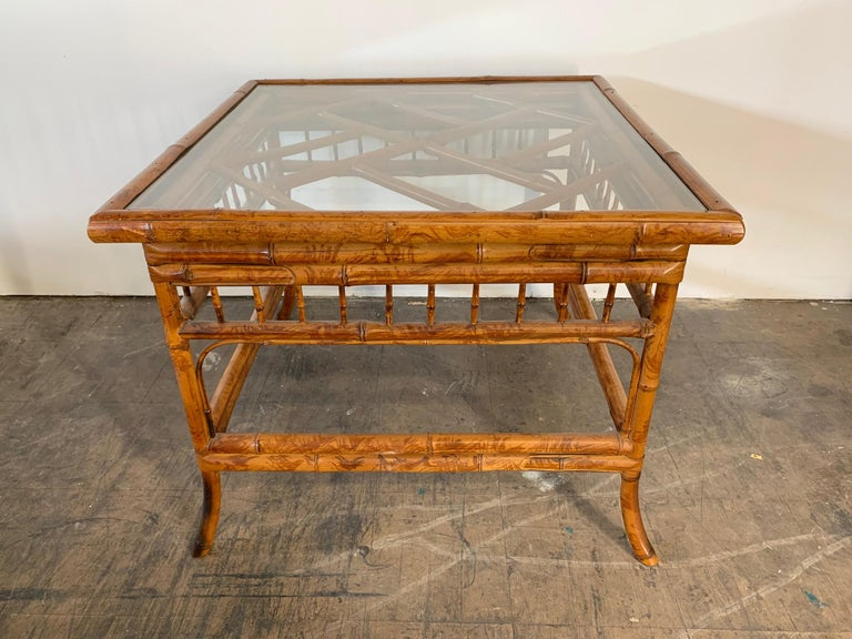 Asian chinoiserie style tiger bamboo side table with glass top. Excellent vintage condition.