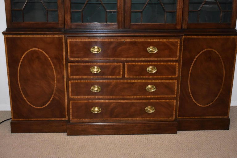 Chippendale mahogany breakfront secretary Collectors Edition by Baker. Flamed mahogany banded inlaid doors and drawers. Bent glass panels individually hand glazed into the doors. 3/8