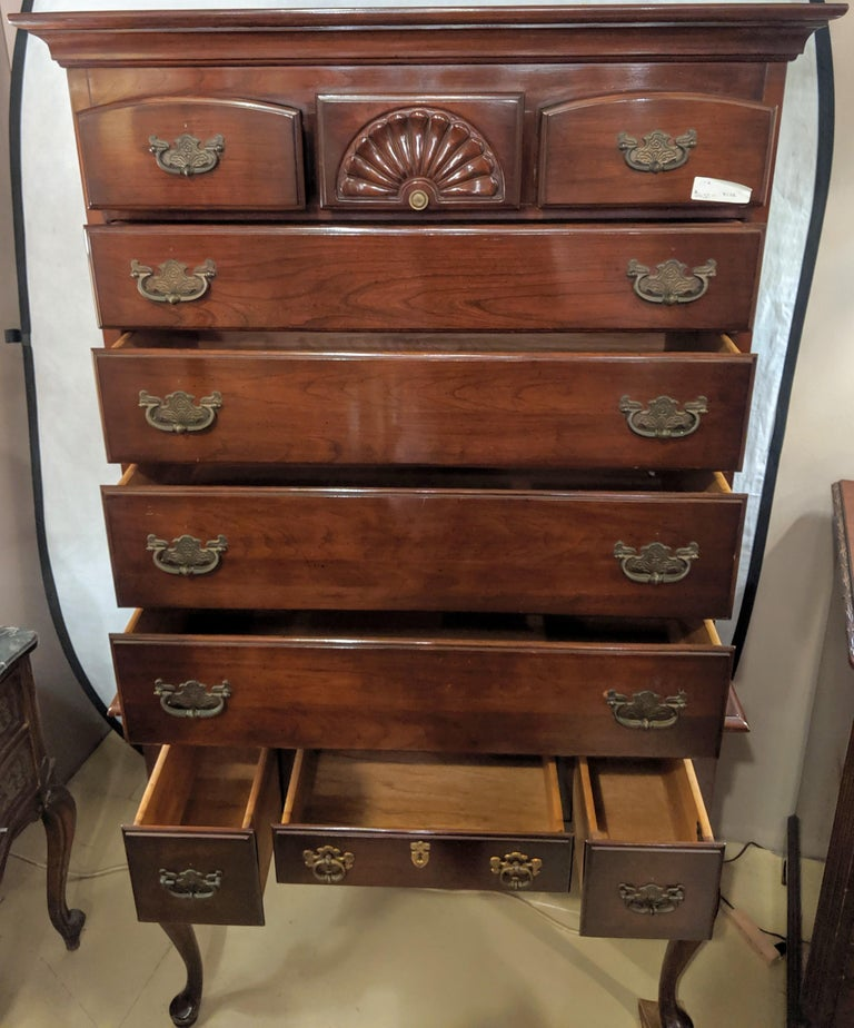 Chippendale Queen Anne two-piece chest on chest by Monitor Furniture Company. On sleek slender ball and claw cabriole legs with a center drawer flanked by a set of side drawers the low boy supporting an upper case of seven drawers three over four.