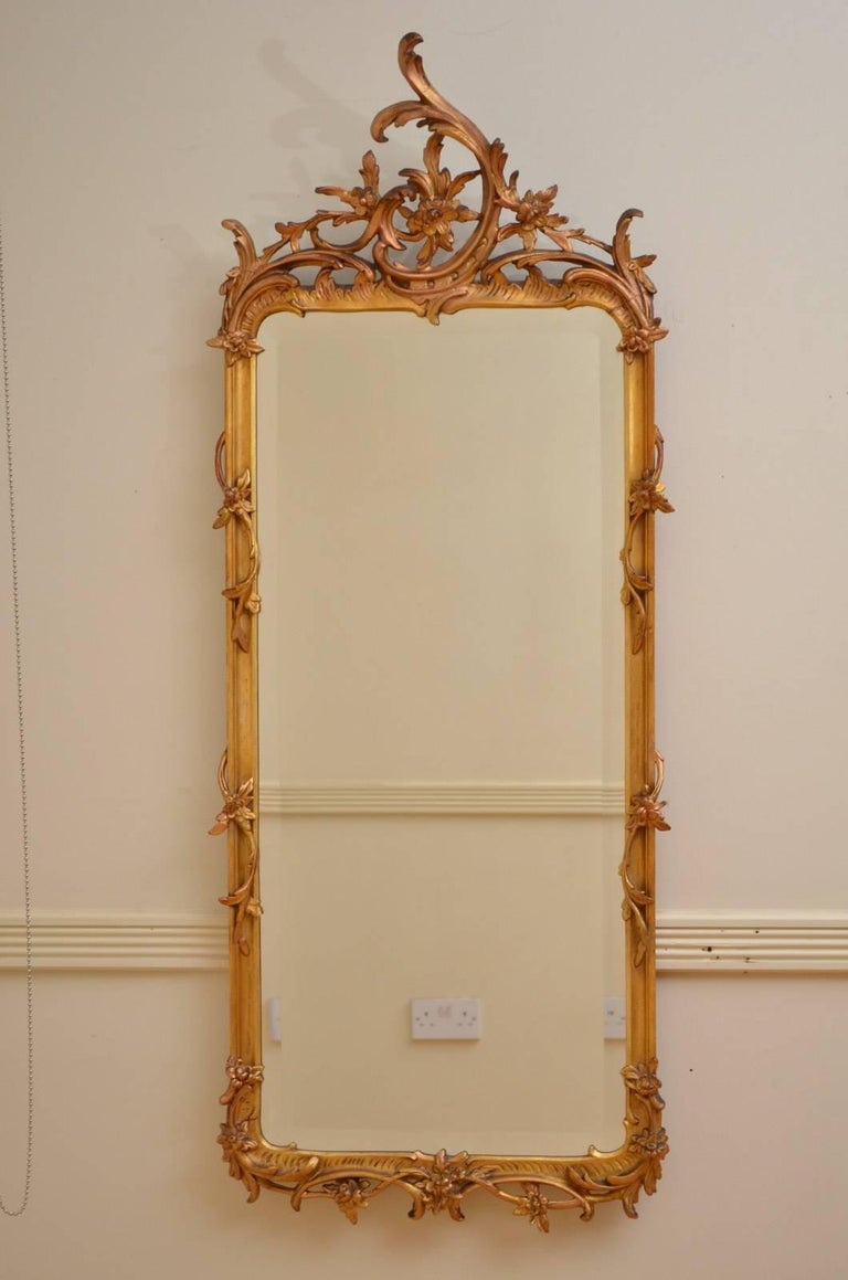 Sn4339 Turn of the century Rococo design gilded pier mirror, having original bevelled edge glass in scroll, rocaille and flower decorated frame, all in home ready condition. c1900