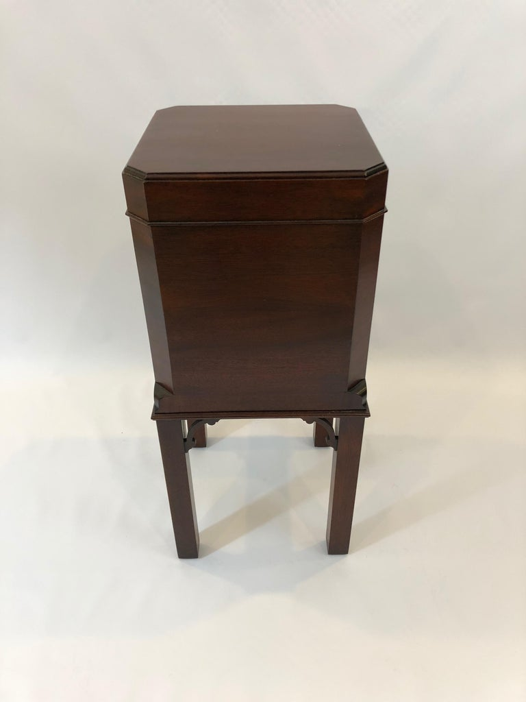 A small beautifully crafted mahogany cellarette used to house bottles of wine and also functions as an interesting end or side table cabinet. By tradition house Williamsburg Edition, stamped on bottom. Measures: Interior 12 x 11.25.