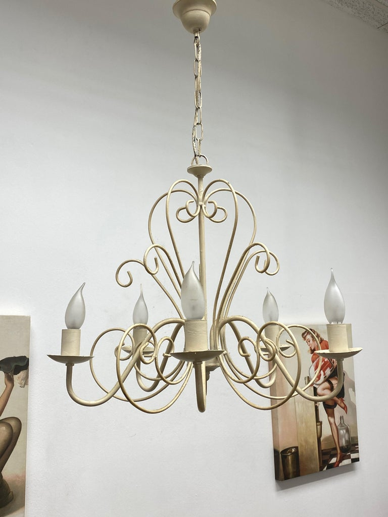 Add a touch of opulence to your home with this charming chandelier! It looks like a castle chandelier, to enhance any chic or eclectic home. We'd love to see it hanging in an entryway as a charming welcome home. The fixture requires five European