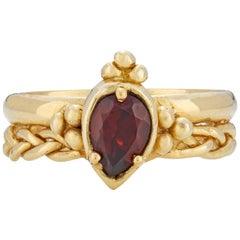 Chiron Ring, 18 Karat Yellow Gold with Garnet