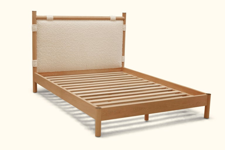 The Chiselhurst bed with no footboard is an upholstered bed with a solid American walnut or white oak frame finished with brass caps. Slats are provided.  As Shown: $5,595 To Order: $4,650 + COM.
