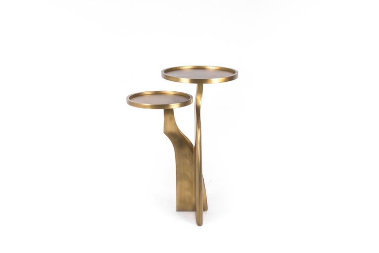 The Chital 2-top side table is both dramatic and organic it's unique design. The 2-top sits and pair of ethereal and sculptural legs are all fully inlaid in bronze-patina brass. This piece makes for the perfect end table and is originally inspired